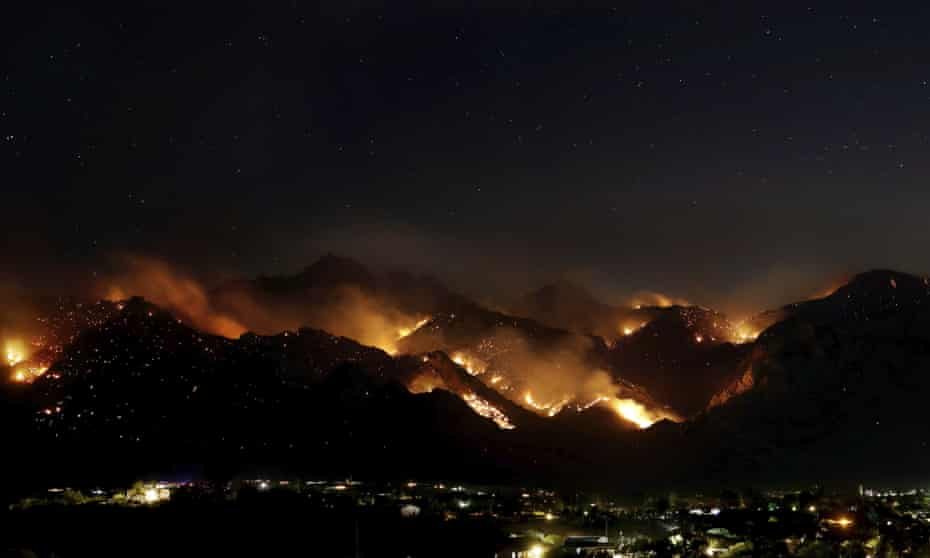 'At night you can see basically the outline of the fire on the mountain': the Bighorn Fire burning in the wilderness of the Santa Catalina Mountains looms over homes as seen from Oro Valley, Arizona, last month.