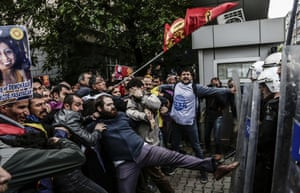 Protesters clash with Turkish riot police during a demonstration against the bomb attacks in Ankara.