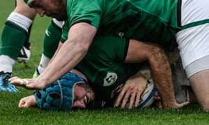 Will Connors scores his try under a pile of Ireland forwards.