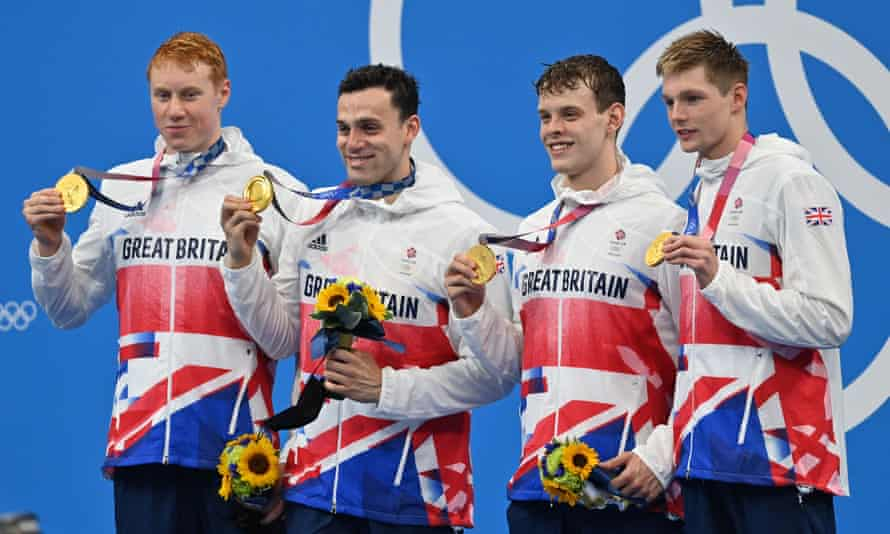 Tom Dean, James Guy, Matthew Richards and Duncan Scott with their gold medals after winning the men's 4x200m freestyle