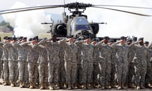 Troops saluting by helicopter