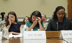 Rashida Tlaib, center, wipes her eyes after testifying before the House oversight committee hearing on family separation and detention centers.