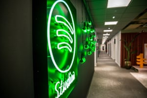 Spotify neon sign in office hallway