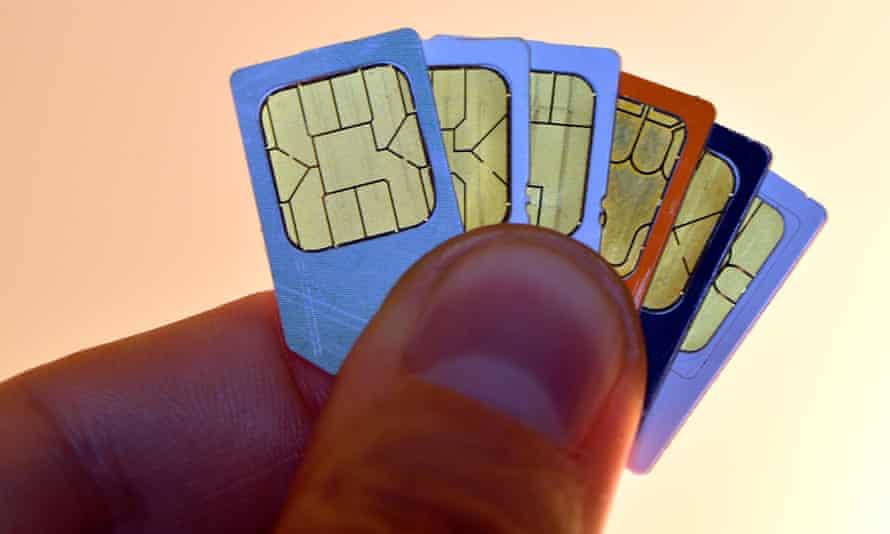Hand holding sim cards