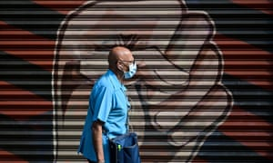 A man wearing a face mask walks in downtown in Mexico City amid the coronavirus pandemic.