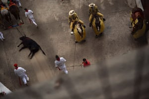 A bull from the Jandilla ranch is dragged out of the bullring at the San Fermin fiesta in Pamplona, Spain.
