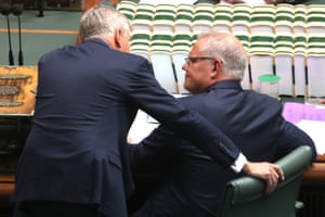 Prime minister Scott Morrison talks with deputy PM Michael McCormack during question time
