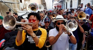 The excitement of the New Orleans carnival merged with the traditional Cuban conga in a colourful parade in Old Havana