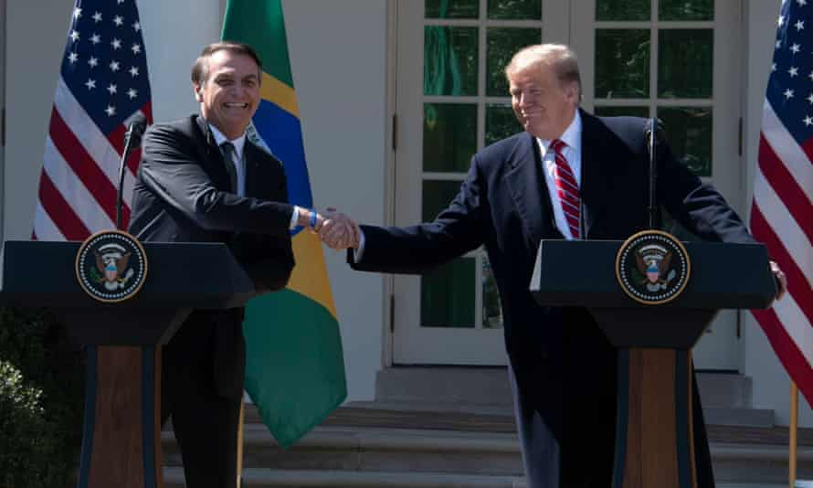 Donald Trump and President Jair Bolsonaro of Brazil shake hands at the conclusion of their joint press conference in the Rose Garden of the White House on Tuesday.