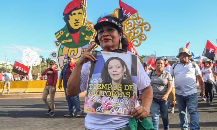 A woman holds a picture of the Nicaraguan vice-president, Rosario Murillo, during a demonstration called 'Love in times of Covid-19', in Managua in March.