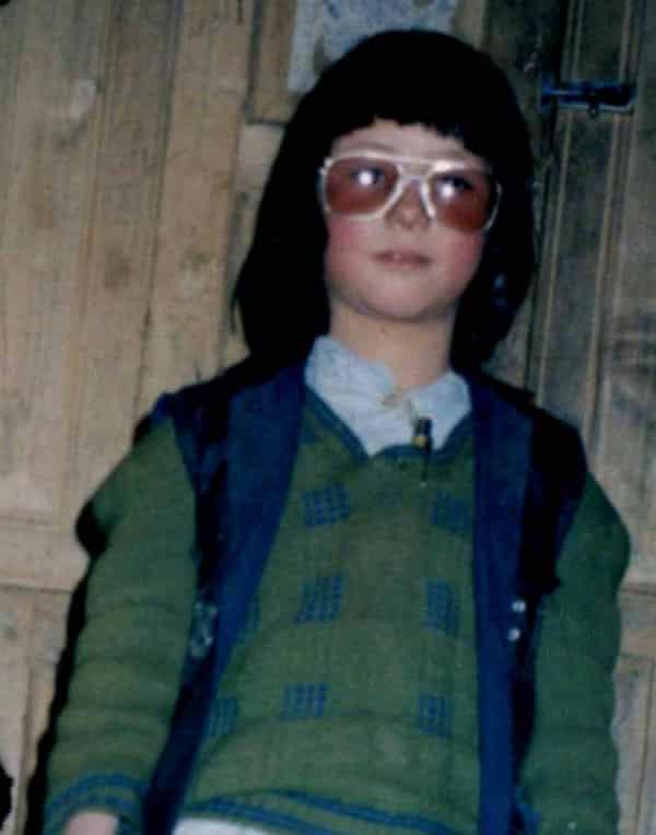 Joya, aged 8, dressed as a boy to go to school.
