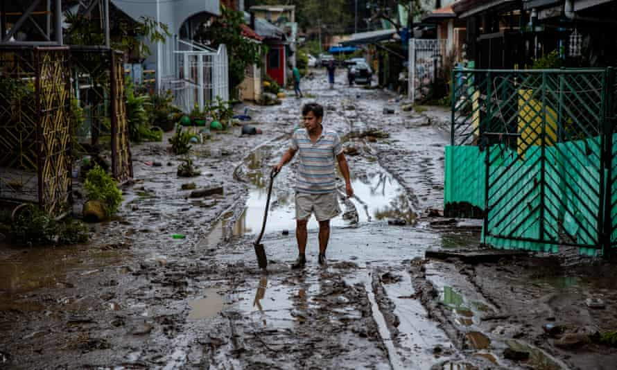 A man shovels mud in the aftermath of Typhoon Goni in Batangas, south of Manila, Philippines