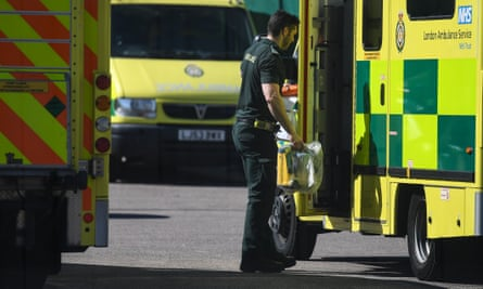 Paramedic opens the door to the ambulance