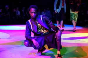Coloured lights and rave music … a model at the Comme des Garçons men's fashion week show.