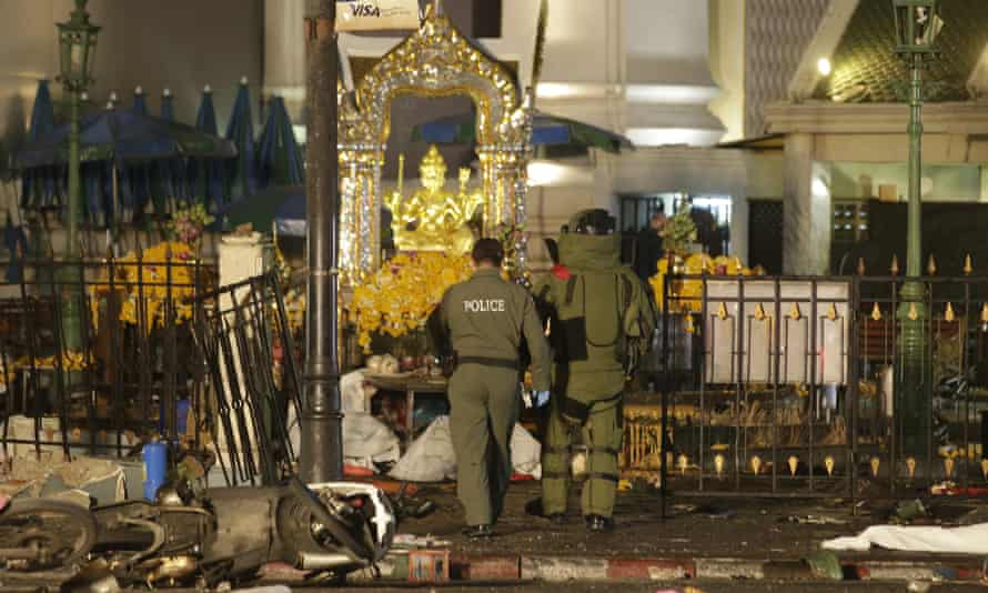 Disposal officers enter the Erawan shrine in Bangkok after the explosion.