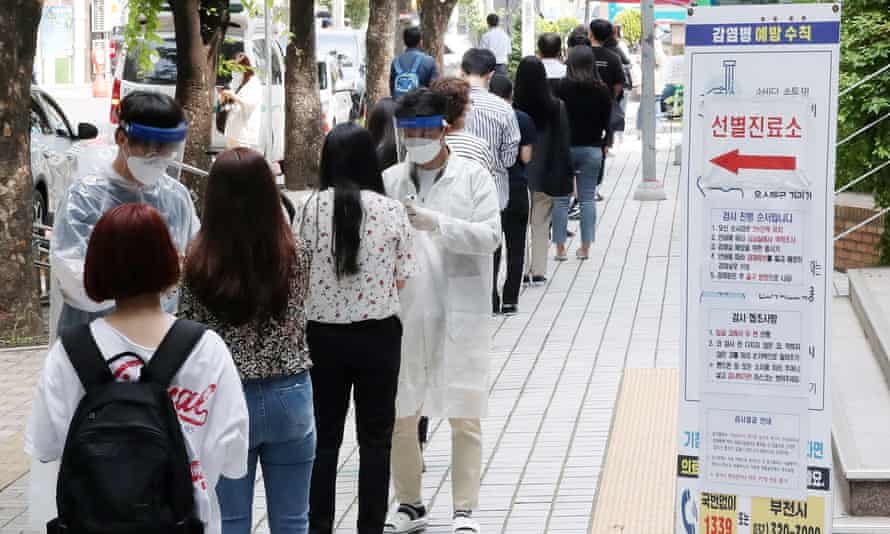 People queue at an outdoor clinic testing clinic in Bucheon, South Korea.