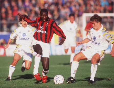 George Weah of AC Milan takes on the Parma defence during their Serie A match at the Ennio Tardini Stadium, Parma in November 1995