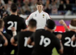England captain Owen Farrell smiles at the All Blacks as they perform the haka before the semi-final at Yokohama International Stadium.
