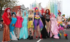 People pose in costume ready for the Auckland pride parade in 2018