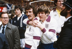 Terry McDermott is seen here being hugged by Emlyn Hughes before a match between England and Scotland at Wembley in 1979, McDermott was known to teammates as 'Lege'. He certainly has one of the games most legendary moustaches.