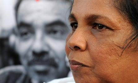 Sandhya Eknaligoda stands before an image of her husband, missing Sri Lankan cartoonist and journalist Prageeth Eknaligoda in 2012.