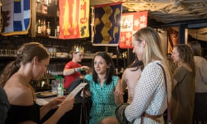 Anglophiles and friends, left to right, Jennifer Tolbert, Maggie Phillips, and Marie Hokenson, check out the Royal Wedding Pub, a pop-up bar in Washington DC.