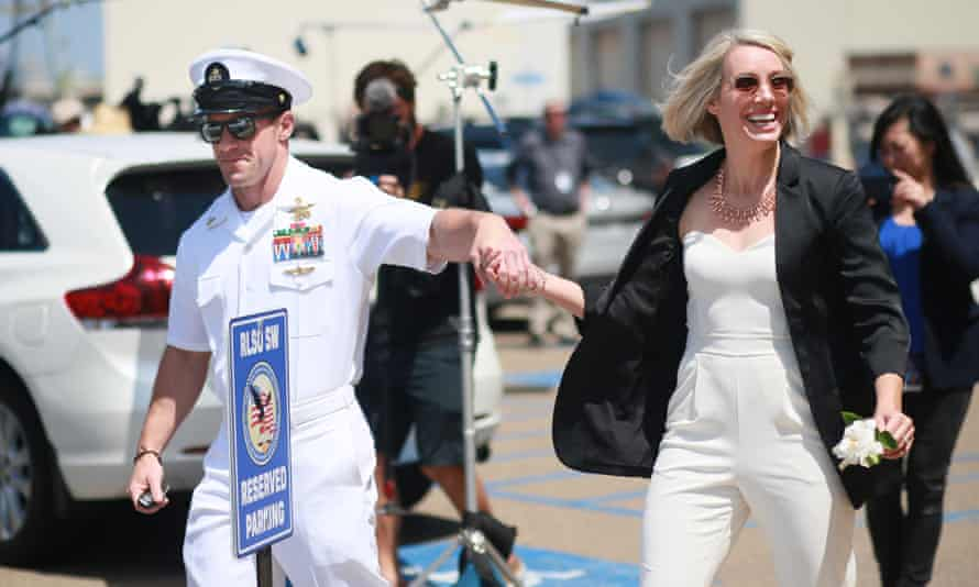 Chief petty officer Eddie Gallagher walks out of military court with his wife Andrea Gallagher during lunch recess on 2 July 2019 in San Diego, California.