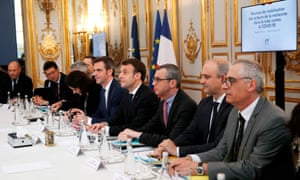 French Health and Solidarity Minister Olivier Veran (C-L) French President Emmanuel Macron (C) and Secretary General of the Elysee Palace Alexis Kohler (C-R) attend a meeting with researchers and scientists about the COVID-19 outbreak at the Elysee Palace in Paris, on March 5, 2020.