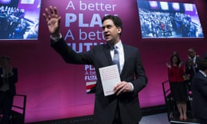 Ed Miliband waves as he arrives to speak at the launch of the party's election manifesto in Manchester, England.