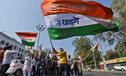 Congress supporters celebrate in December as the party gets the lead in state elections in Bhopal.