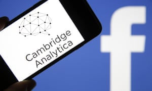 """Cambridge Analytica Accused Of Collecting Personal Information From Facebook Users<br>PARIS, FRANCE - MARCH 20:  In this photo illustration the logo of the strategic communication company """"Cambridge Analytica"""" is seen on the screen of an iPhone in front of a computer screen showing a Facebook logo on March 20, 2018 in Paris, France. Cambridge Analytica is accused of collecting the personal information of 50 million users of the Facebook social network without their consent and would have used it to develop software to predict and influence voter voting during the campaign American election according to the New York Times and the Guardian. Facebook share price fell by more than 5% Monday shortly after the opening of Wall Street.  (Photo Illustration by Chesnot/Getty Images)"""