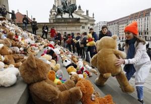 Berlin, Germany Schoolchildren place 740 teddy bears in front of the Konzerthaus