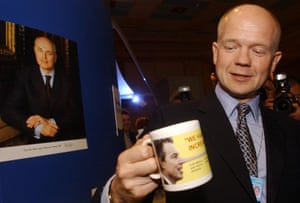 Former Tory leader William Hague admires a mug lampooning Tony Blair at the Conservative Party conference in Blackpool in 2003