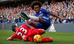 Willian tackled hard by Liverpool's Emre Can.