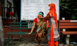 Relatives mourn the death of a man due to coronavirus at a crematorium in New Delhi, India 7 September 2020.
