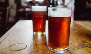 two pints of beer on pub table