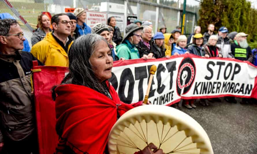 Indigenous leaders and supporters block the entrance to the Kinder Morgan pipeline project terminal work-site in Burnaby, British Columbia, Canada on April 7, 2018.