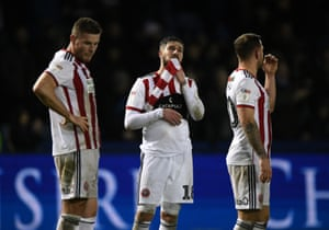 Kieron Freeman of Sheffield United stands dejected with his team mates after the match