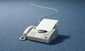 Fax machine on floor of empty room