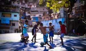 Boys play football in the Borel favela in Rio de Janeiro, Brazil.
