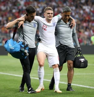 England's Kieran Trippier is helped towards the bench.