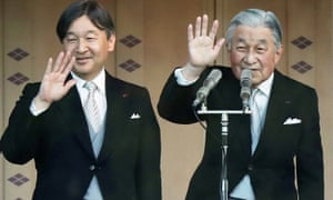 Emperor Akihito (right) and Crown Prince Naruhito wave to crowds at the Imperial Palace in Tokyo.