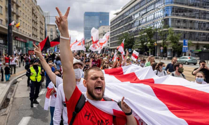 Activists and members of the Belarusian diaspora take part in a rally in Warsaw, Polandry of anti-Lukashenko protests.