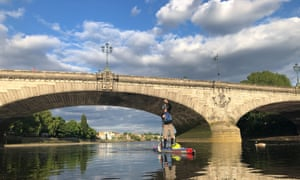 Paddleboarding by Putney bridge over the Thames