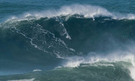 British surfer Tom Butler conquers potential world record '100ft tall wave' – video