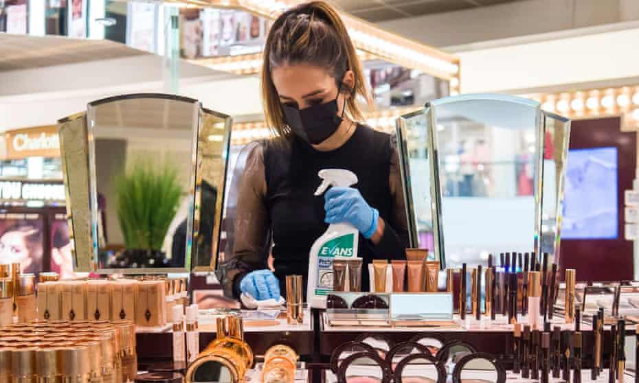 A member of staff at Peter Jones cleans makeup items