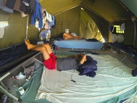 Asylum seekers lie in tents in the detention centre on Nauru: