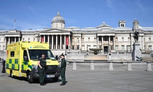 An ambulance parked today in an empty Trafalgar Square in London.