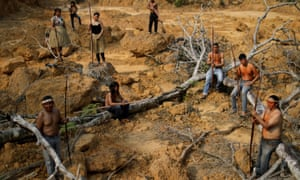 Indigenous people from the Mura tribe show a deforested area in Amazonas state