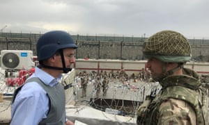 Laurie Bristow speaks with an HMG staff member as they facilitate the UK evacuation effort in Kabul, Afghanistan.